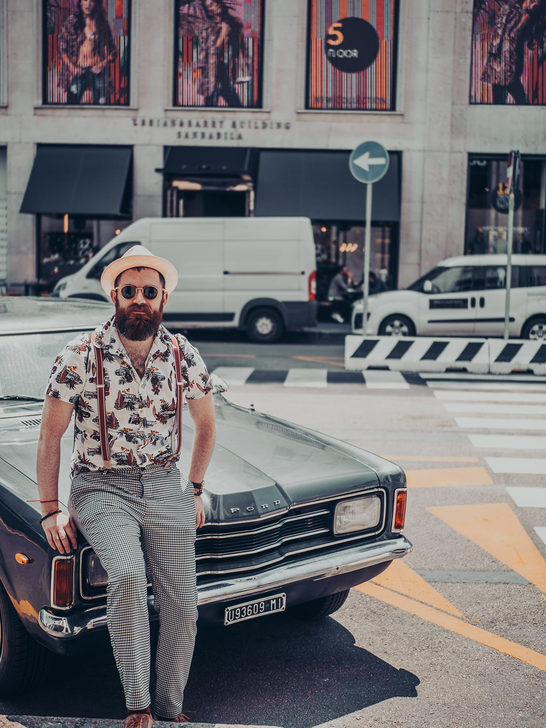 daniel horvath stylish bearded man sitting on a vintage oldtimer ford car