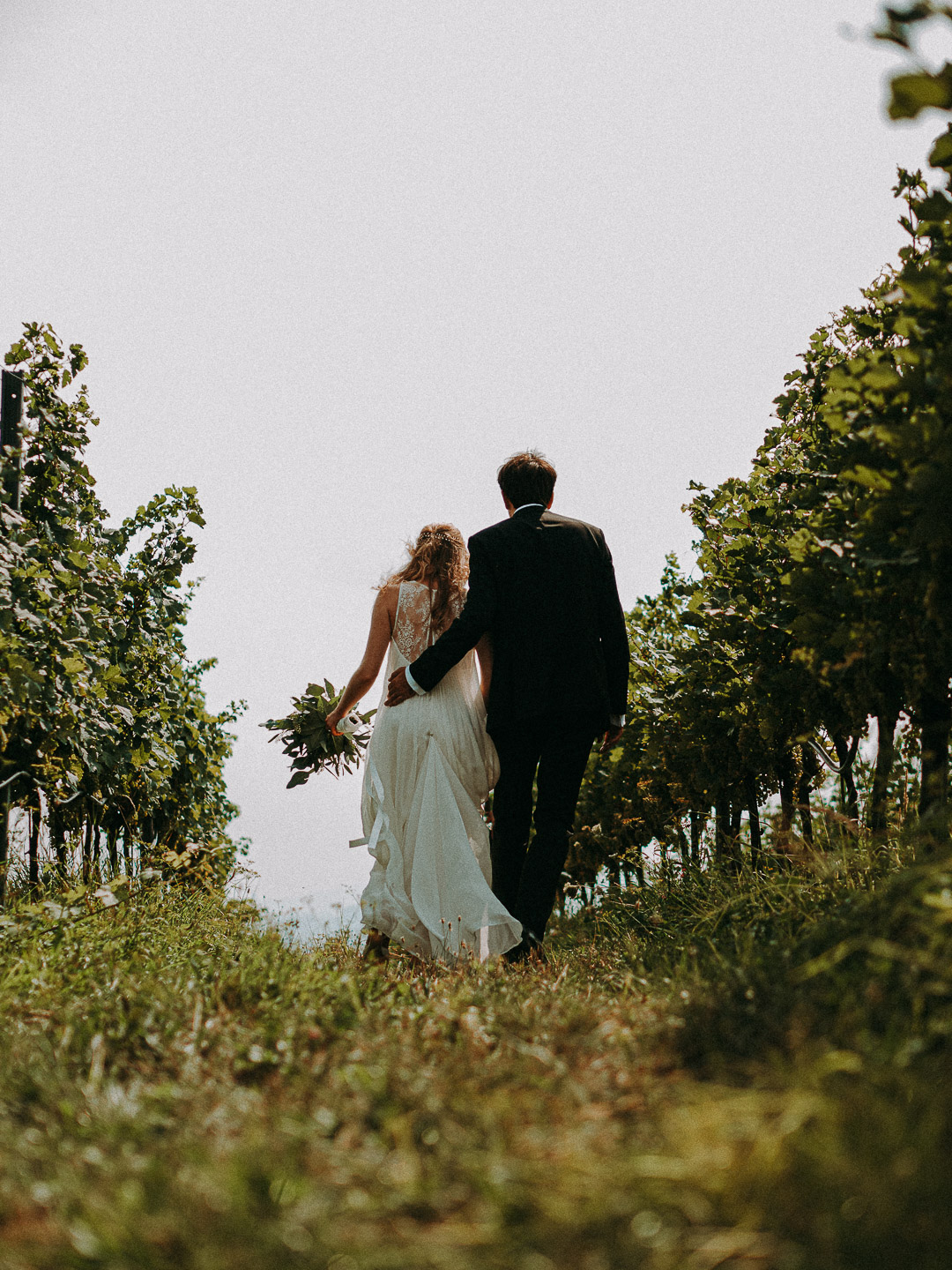 Married couple walking at destination wedding Tuscany winery